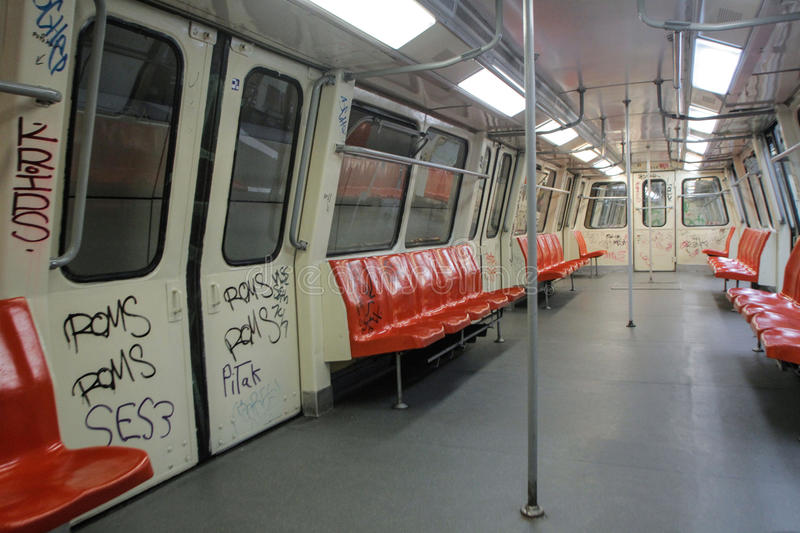 Metro wagon. BUCHAREST, ROMANIA, June 10, 2016: The interior of a metro wagon with red chairs in a metro station in Bucharest stock photography