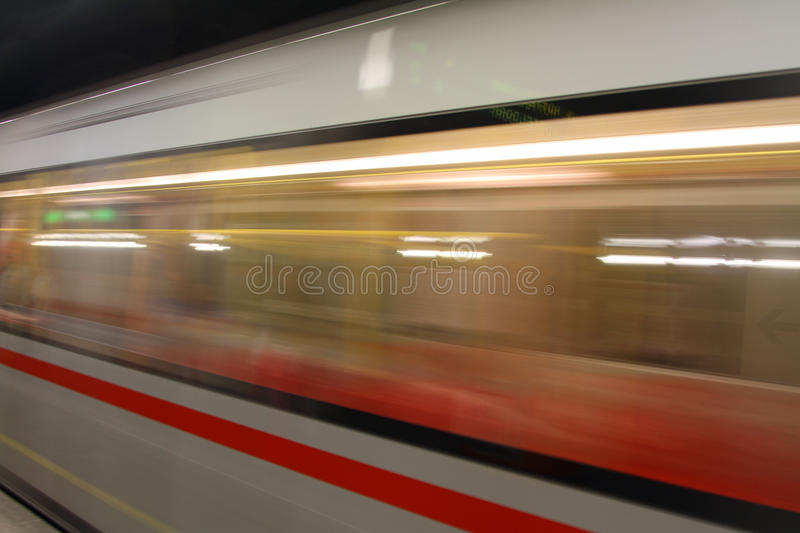 Metro wagon while hurtling fast in station. Fast Metro wagon while hurtling fast in station royalty free stock image