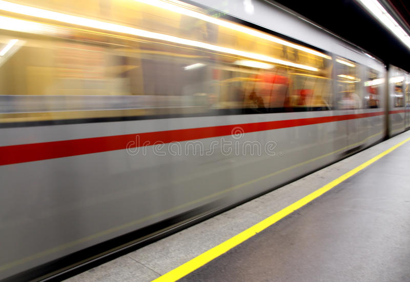 Metro wagon run fast in a underground stop. Metro wagon hurtling in a underground stop royalty free stock photography