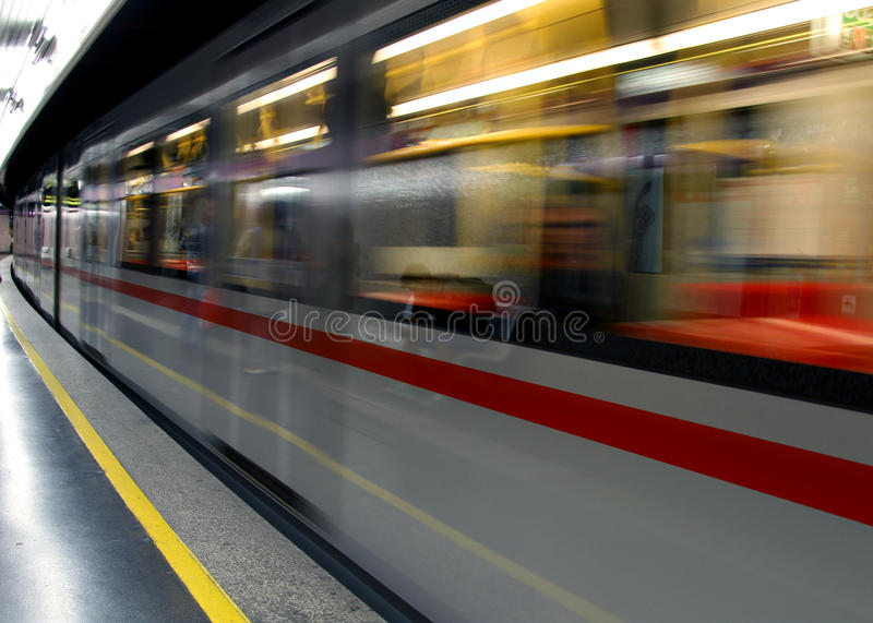 Metro wagon runs in a Metro station. Metro wagon runs quickly in an underground Metro station royalty free stock photo