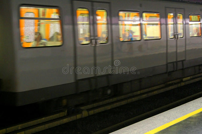 Metro wagon runs in an underground Metro station. Metro wagon runs quickly in an underground Metro station royalty free stock image