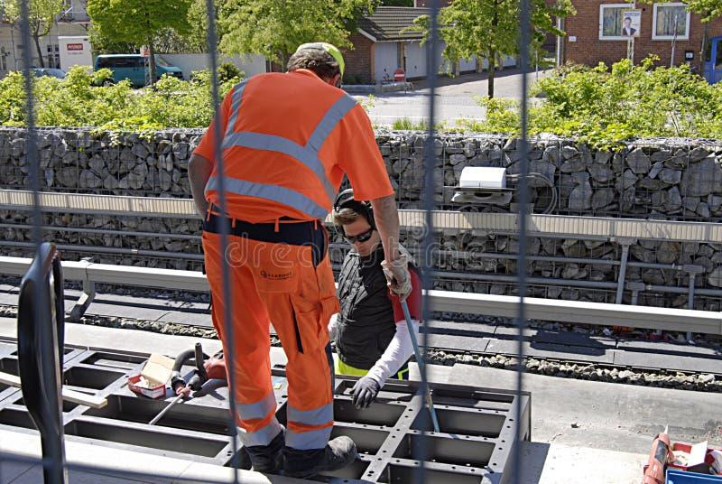Metro workers. KASTRUP /COPENHAGEN /DENMARK- Construction workers at Kastrup metro train station 15 May 2014 (Photo by Francis Dean/Deanpictures royalty free stock photo