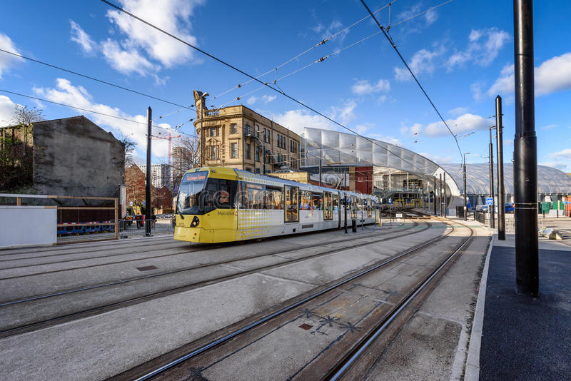 Metrolink Yellow Tram Manchester England. Manchester Metrolink tram leaving Victoria Station in England UK stock photos