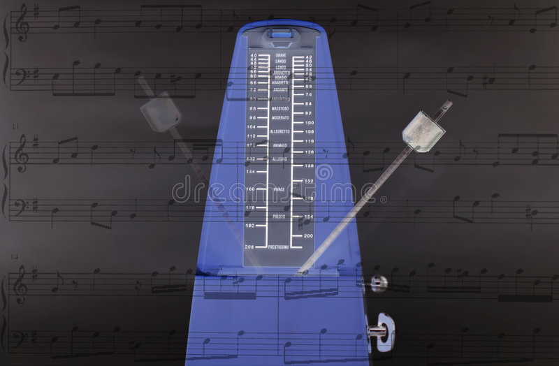 Metronome keeping time royalty free stock images