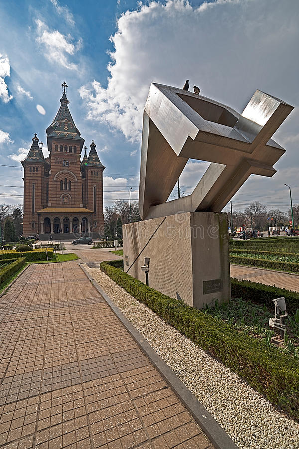 Metropolitan Cathedral and the memorial monument in Timisoara,. TIMISOARA, ROMANIA - MARCH 18, 2016: Fisheye view with the Metropolitan Cathedral and the royalty free stock photography