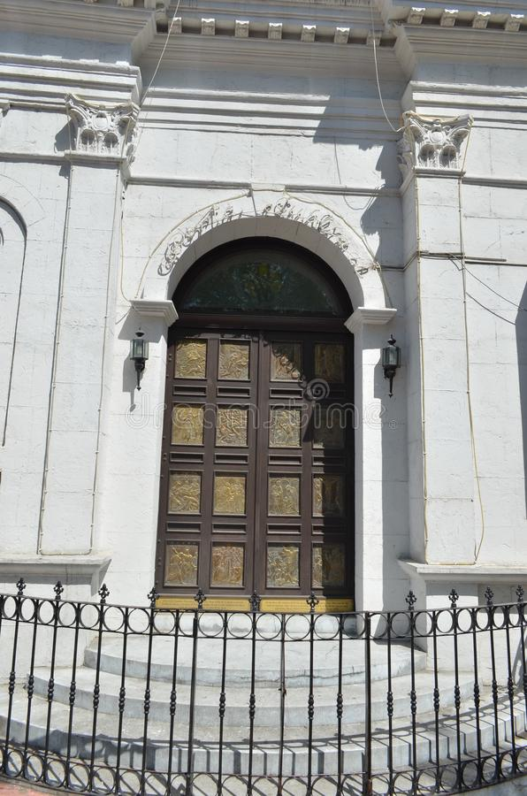 2015: Metropolitan Cathedral and Parish of Saint Vitalis and of the Guardian Angels Entrance. The famous image of Iconic Spanish Colonial door of Metro Cebu royalty free stock photos
