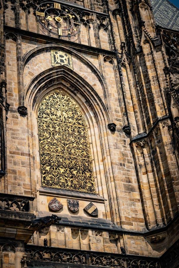 The Metropolitan Cathedral of Saints Vitus, Wenceslaus and Adalbert  commonly named St. Vitus Cathedral. Detail. The Metropolitan Cathedral of Saints Vitus stock photo
