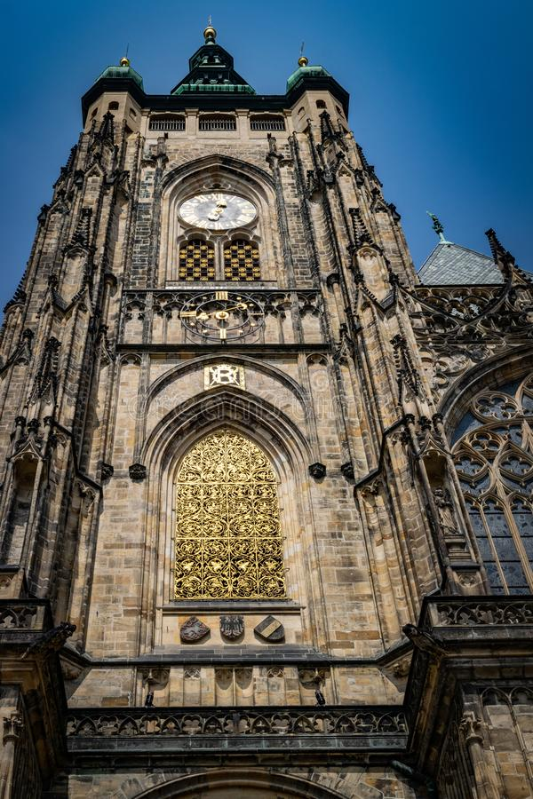 The Metropolitan Cathedral of Saints Vitus, Wenceslaus and Adalbert  commonly named St. Vitus Cathedral. Detail. The Metropolitan Cathedral of Saints Vitus royalty free stock photography