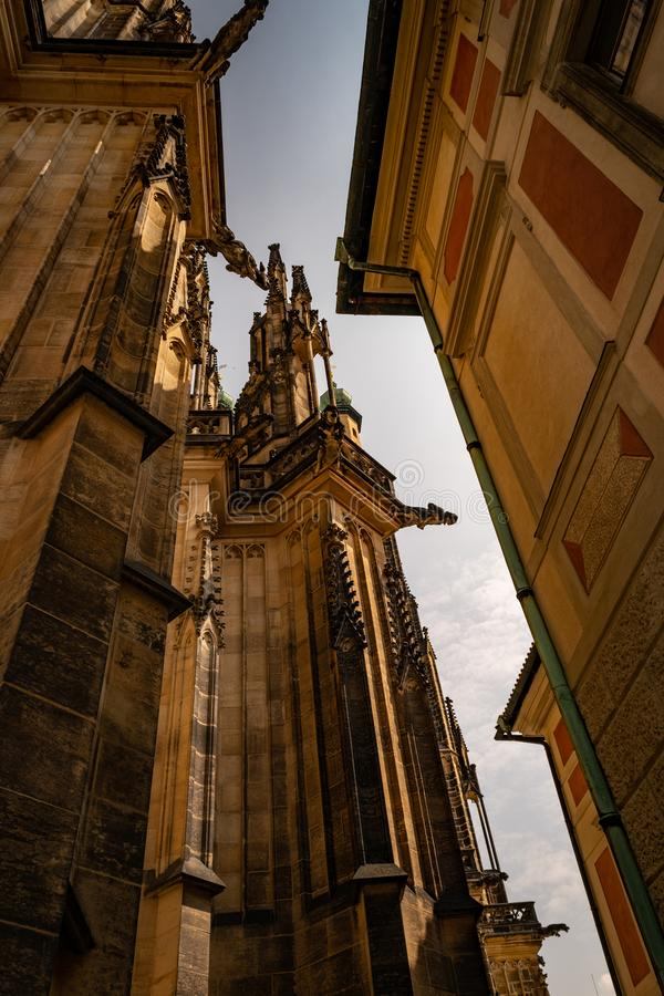 The Metropolitan Cathedral of Saints Vitus, Wenceslaus and Adalbert  commonly named St. Vitus Cathedral. Is a prominent example of Gothic architecture and is royalty free stock images