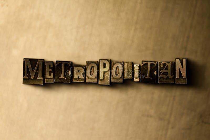 METROPOLITANO - il primo piano dell'annata grungy ha composto la parola sul contesto del metallo royalty illustrazione gratis