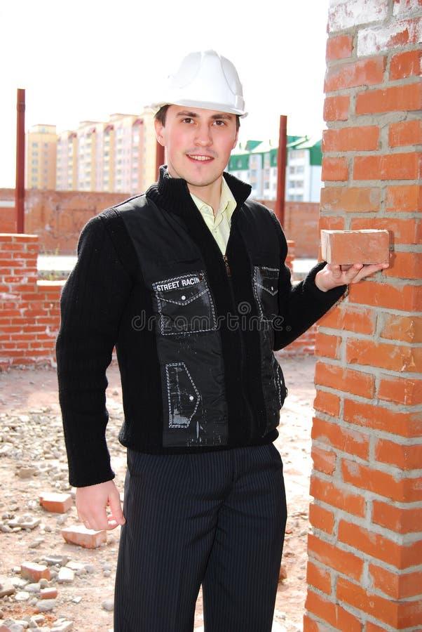 Metselaar met baksteen. royalty-vrije stock foto