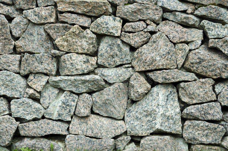 Metselwerk van het metselwerk van granietstenen stock foto's