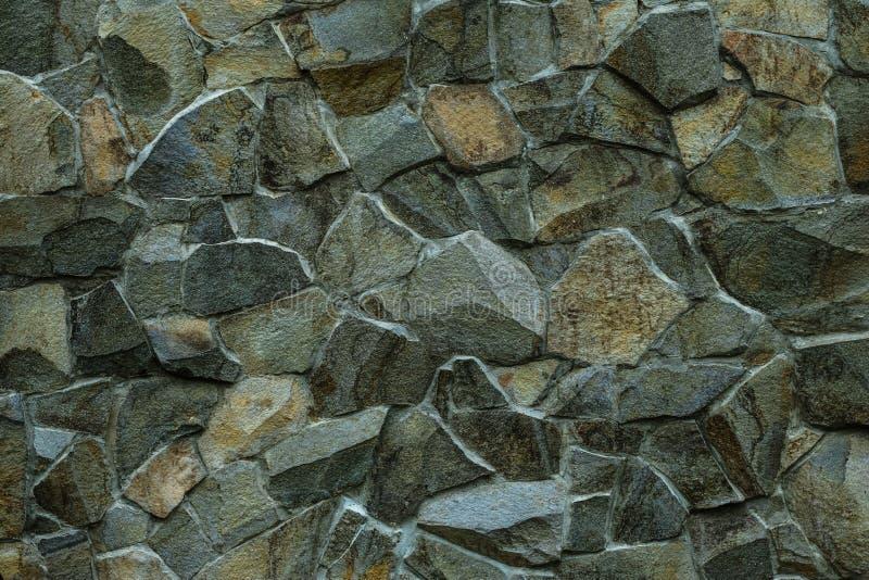 Metselwerktextuur De groene grijze achtergrond van de steenmuur Metselwerk van decoratieve tegel Abstract patroon van grijze rots stock afbeeldingen