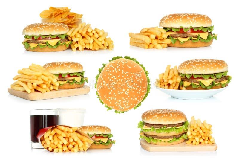 Metta degli hamburger, delle patate fritte e delle patatine fritte con cola fotografia stock