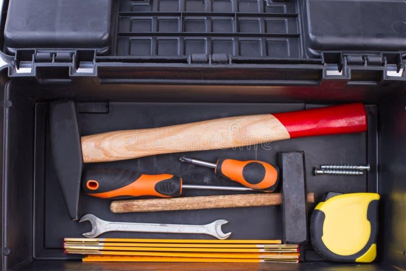 Metta degli strumenti della costruzione in scatola nera immagini stock