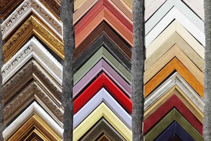 Metta dei campioni di legno solidi degli angoli delle cornici della foto fotografia stock