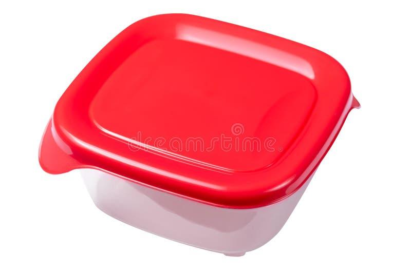 Metta dei recipienti di plastica con il coperchio rosso isolato su fondo bianco fotografia stock libera da diritti