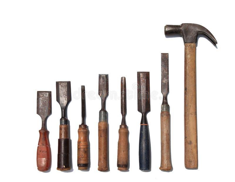 Metta dell'oggetto di scultura di legno dell'attrezzatura isolato su fondo bianco fotografia stock libera da diritti