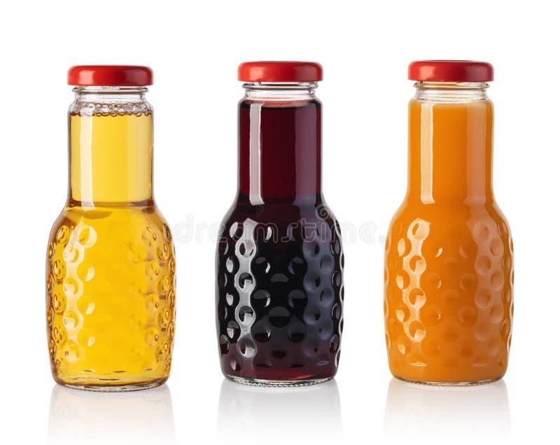 Metta della bottiglia del succo fotografia stock libera da diritti
