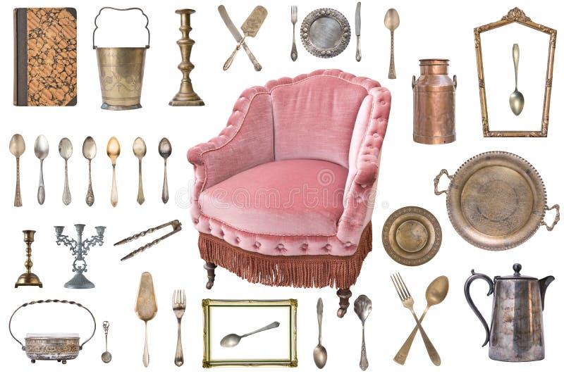 Metta di bei oggetti antichi, le cornici, la mobilia, argenteria retro annata Isolato su priorit? bassa bianca fotografie stock libere da diritti