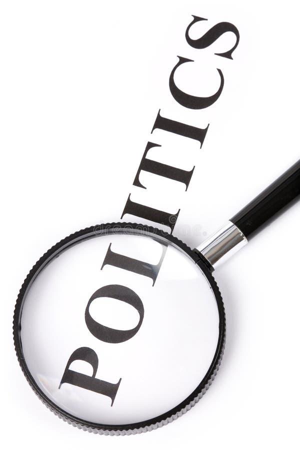 Metta in evidenza la politica ed il magnifier immagini stock