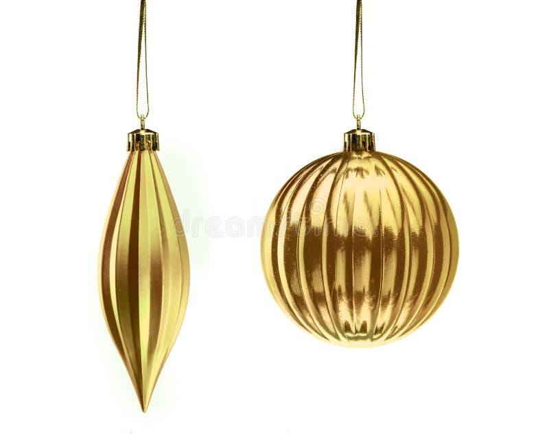 Metta gli elementi della decorazione di Natale dell'oro isolati sul backgro bianco fotografia stock libera da diritti
