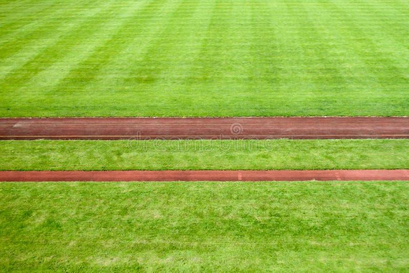 Mette in mostra lo stadio con le piste di corsa immagini stock