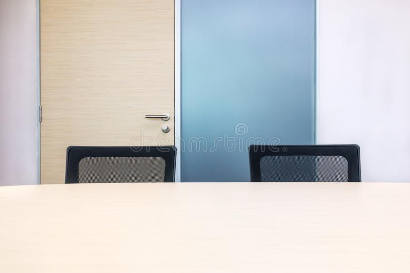 The metting room have wood desk and black chairs. Office interview room. stock illustration