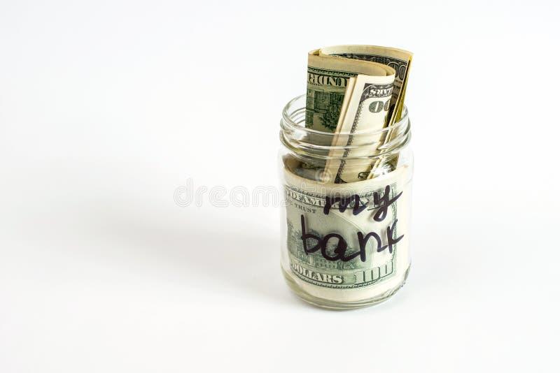 Meu banco escrito em um frasco com cédulas do dólar Conceito das finanças das economias e da casa fotos de stock royalty free