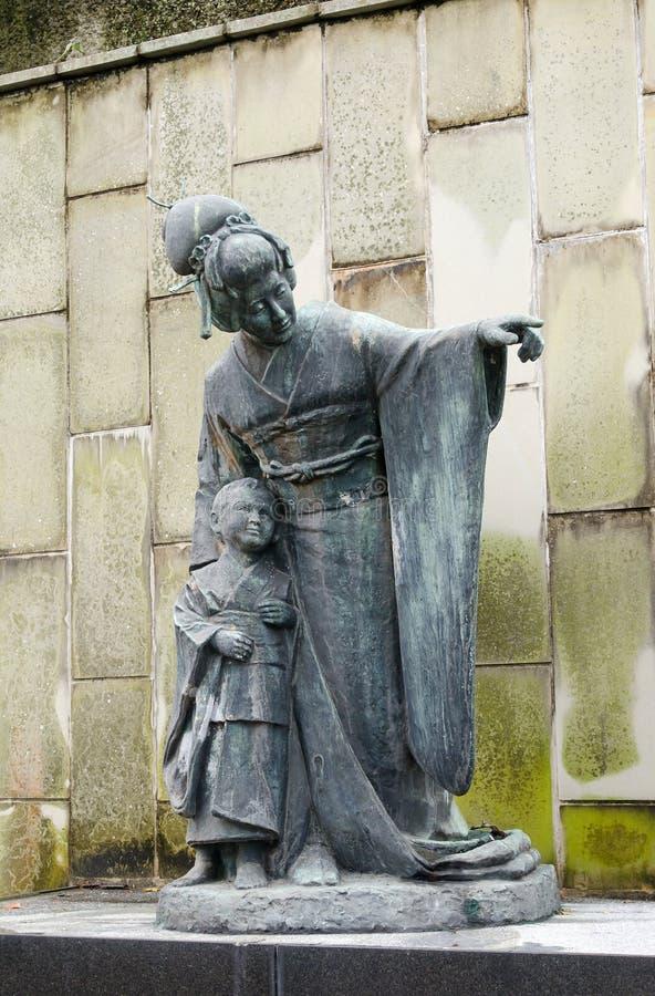 Mevrouwbutterfly standbeeld stock foto's