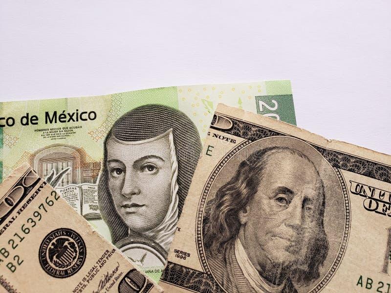 Mexicaans bankbiljet van 200 peso's en gebroken Amerikaans bankbiljet van 100 dollars