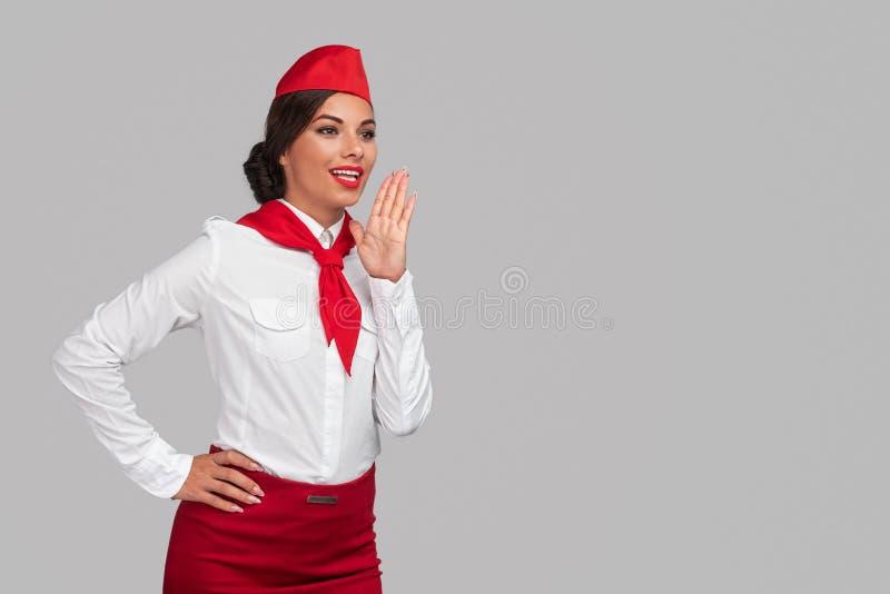 Mexicaanse stewardess die een aankondiging doet stock fotografie