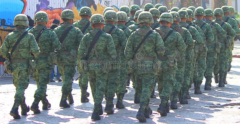 Mexican army soldiers marching in San Cristobal de la Casas royalty free stock image