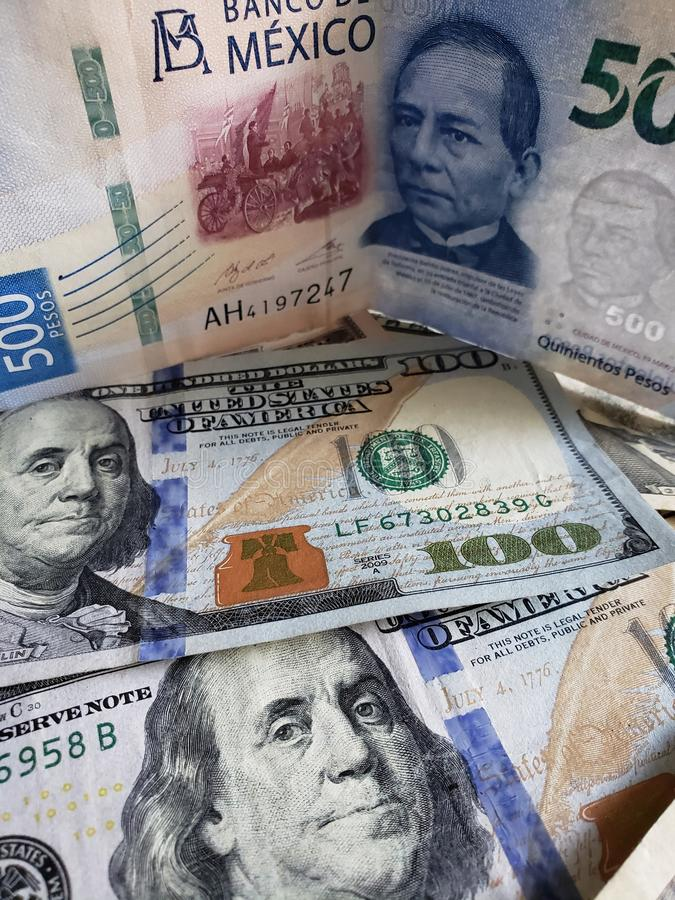 Mexican banknote of 500 pesos and American 100 dollars bills. Commerce, exchange, trade, trading, value, buy, sell, profit, price, rate, cash, currency, paper stock photography