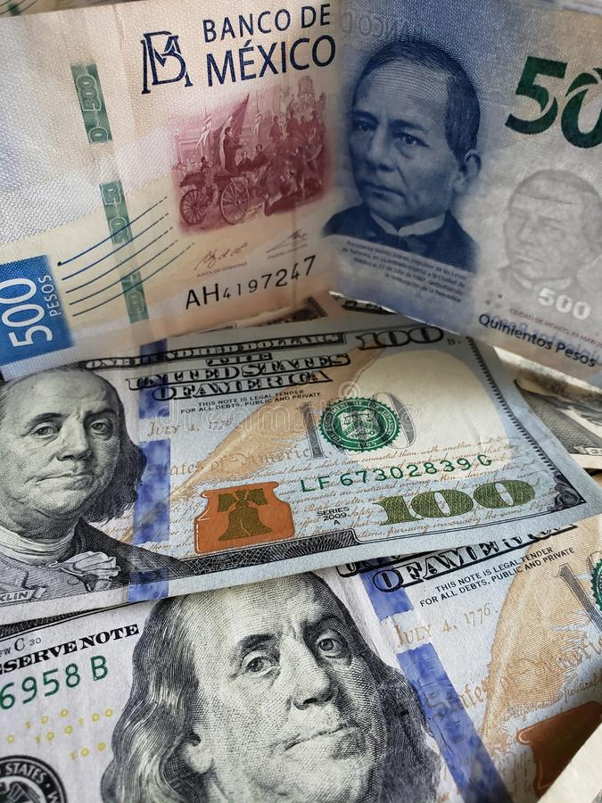 Mexican banknote of 500 pesos and American 100 dollars bills. Commerce, exchange, trade, trading, value, buy, sell, profit, price, rate, cash, currency, paper stock photos
