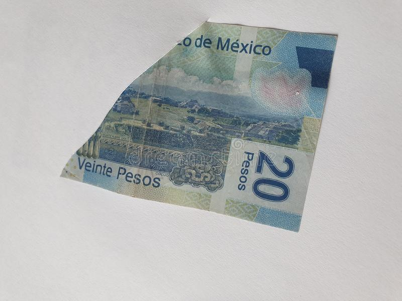 Mexican banknote of twenty pesos on the broken sheet of paper. Commerce, exchange, trade, trading, value, buy, sell, profit, price, rate, cash, currency, paper royalty free stock photos