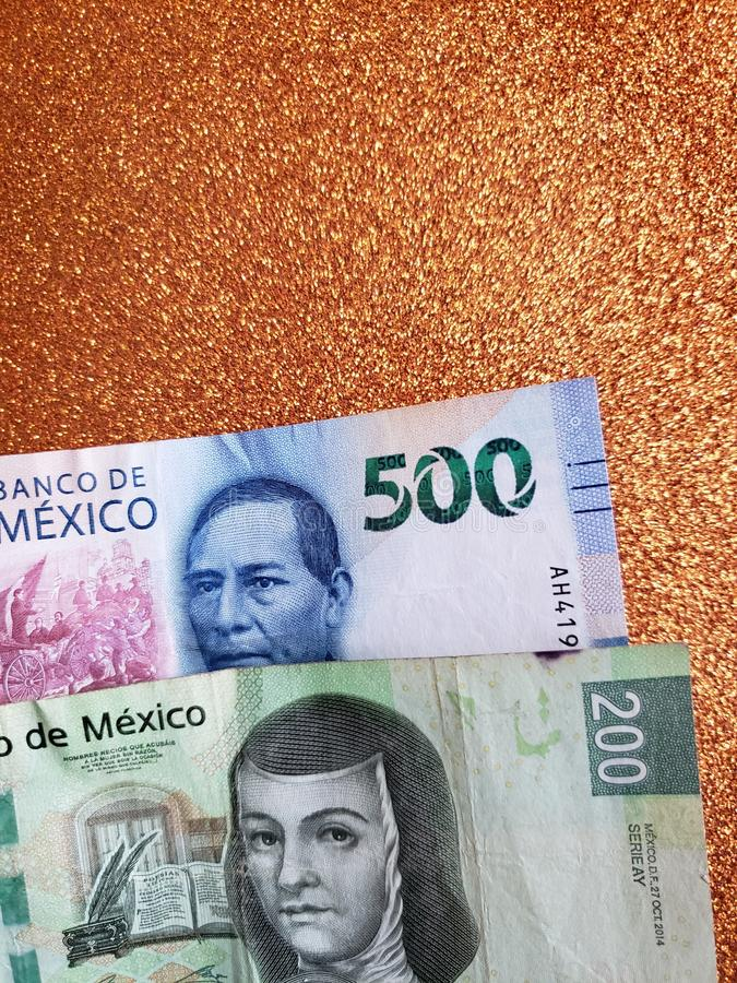 Mexican banknotes and background in metallic copper color. Commerce, exchange, trade, trading, value, buy, sell, profit, price, rate, cash, currency, paper royalty free stock photos