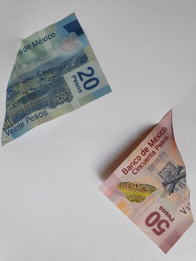 Mexican banknotes of different denominations on the broken sheet of paper. Commerce, exchange, trade, trading, value, buy, sell, profit, price, rate, cash stock photos