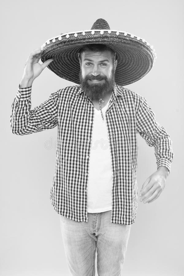 Mexican bearded guy ready to celebrate. Customs and traditions. Man wear sombrero mexican hat. Vacation travel festival. And holidays. Join fest. Mexican royalty free stock images