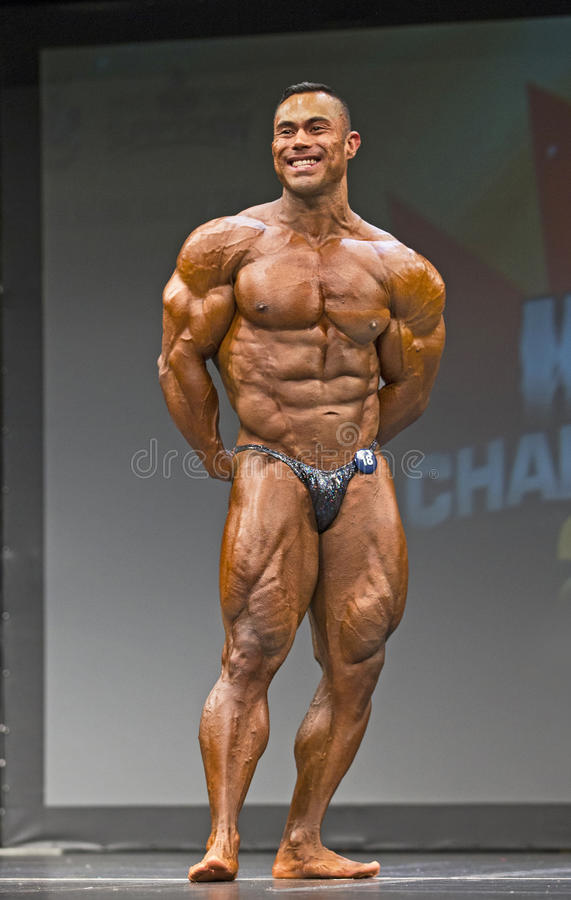 Mexican Bodybuilder Flexes in Toronto. Bodybuilder Benjamin Parra Mexico, shows off an outstanding, powerful double biceps pose and earned 5th place in the royalty free stock image