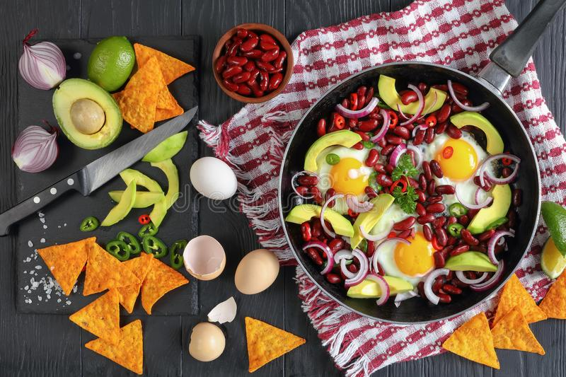 Mexican breakfast - fried eggs in skillet stock photography