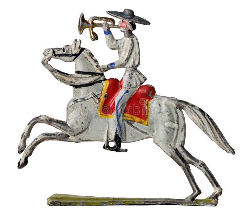Mexican Bugler. Ancient tin toy sollier. Mexican horseman bugler in traditional clothes against white background stock photo