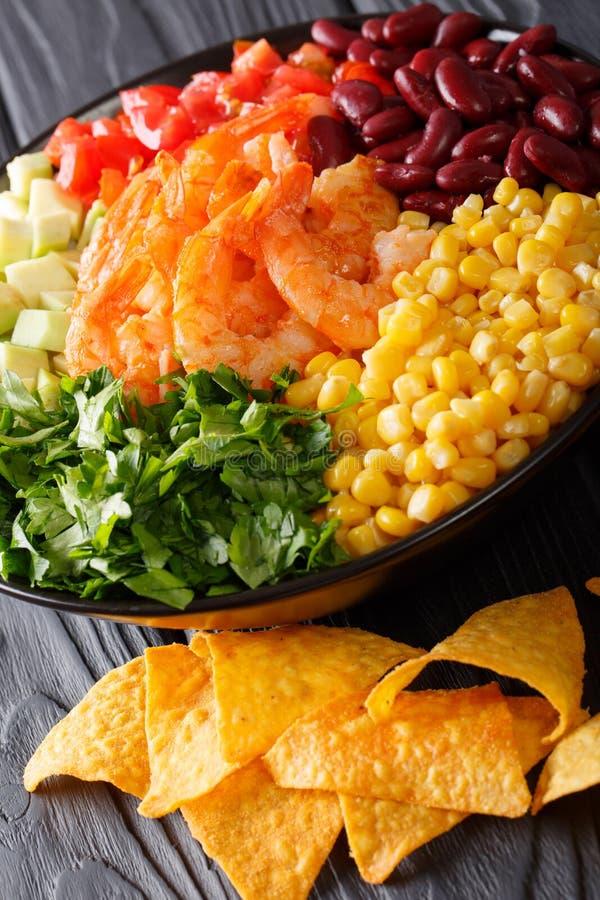 Mexican burrito bowl with shrimp, beans, corn, avocado and herbs royalty free stock photos