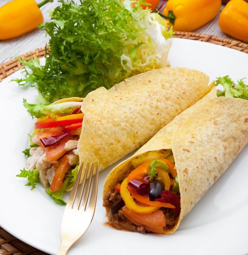 Mexican burritos on white dish. Original mexican burritos on white dish royalty free stock photography