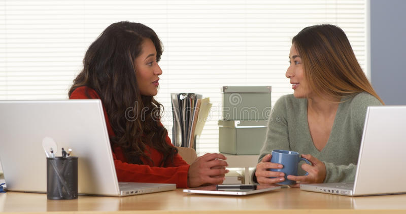 Mexican businesswoman talking with Japanese colleague stock images