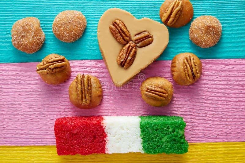 Mexican candy cajeta pecan coconut flag. Mexican candy sweets cajeta pecan and coconut flag stock photography