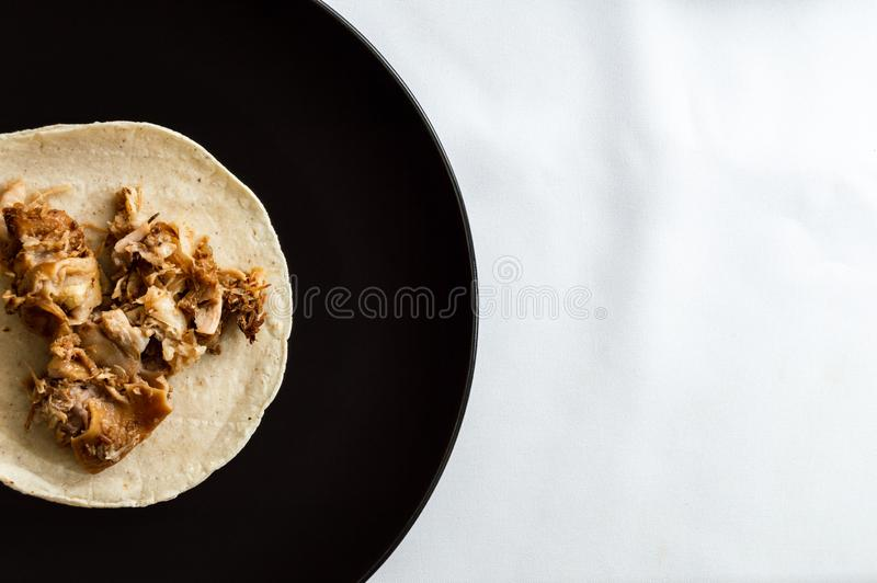Mexican carnitas tacos, traditional food of Michoacán. Mexican carnitas tacos, slow cooked pulled pork, traditionally from the state of Michoacán and made royalty free stock photos