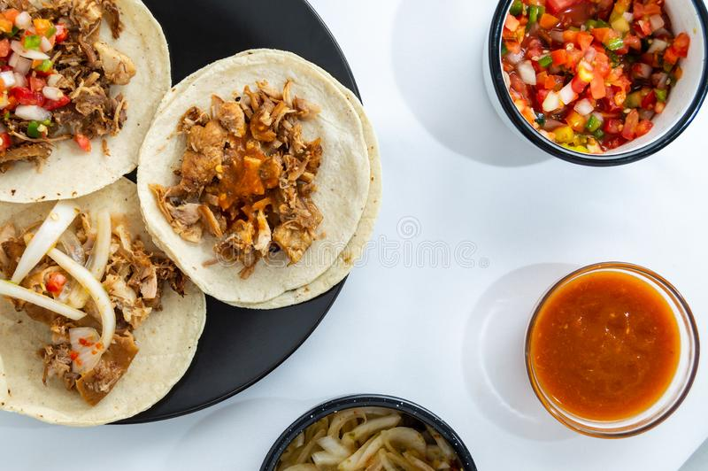 Mexican carnitas tacos, traditional food of Michoacán. Mexican carnitas tacos, slow cooked pulled pork, traditionally from the state of Michoacán and made stock photo