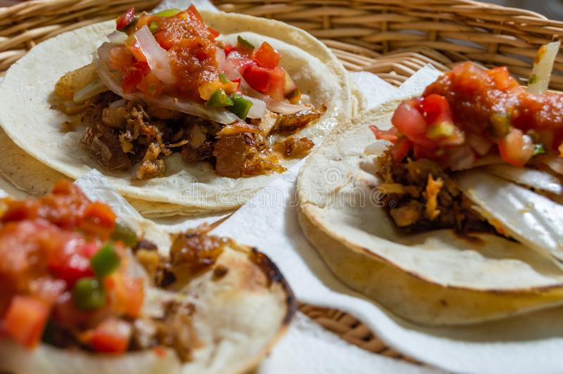 Mexican carnitas tacos, traditional food of Michoacán. Mexican carnitas tacos, slow cooked pulled pork, traditionally from the state of Michoacán and made stock images