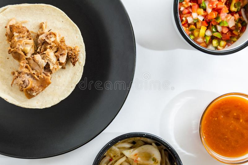 Mexican carnitas tacos, traditional food of Michoacán. Mexican carnitas tacos, slow cooked pulled pork, traditionally from the state of Michoacán and made stock image